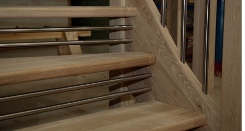 Open riser staircase with twin bars