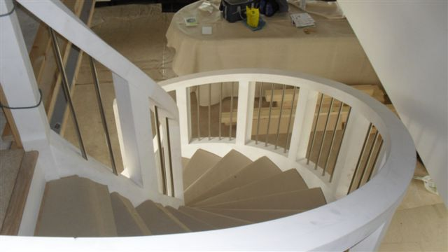 looking down the curved staircase