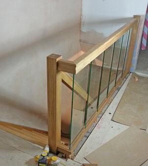 Glass Panels Along A Landing Banister