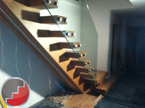 Oak staircase with large glass panels