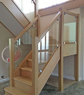 Oak staircase Vision glass balustrade with brackets