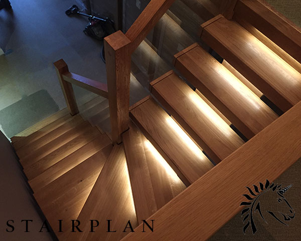 oak x-vision staircase with led lights and tread recessed glass