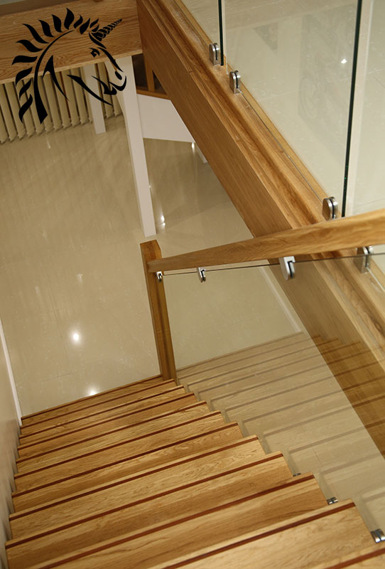 oak staircase with dark hardwood strip for cotrasting stair nosings