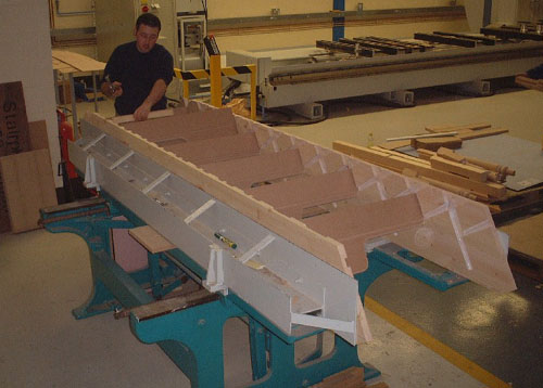 A budget Spacesaver being assembled in the factory