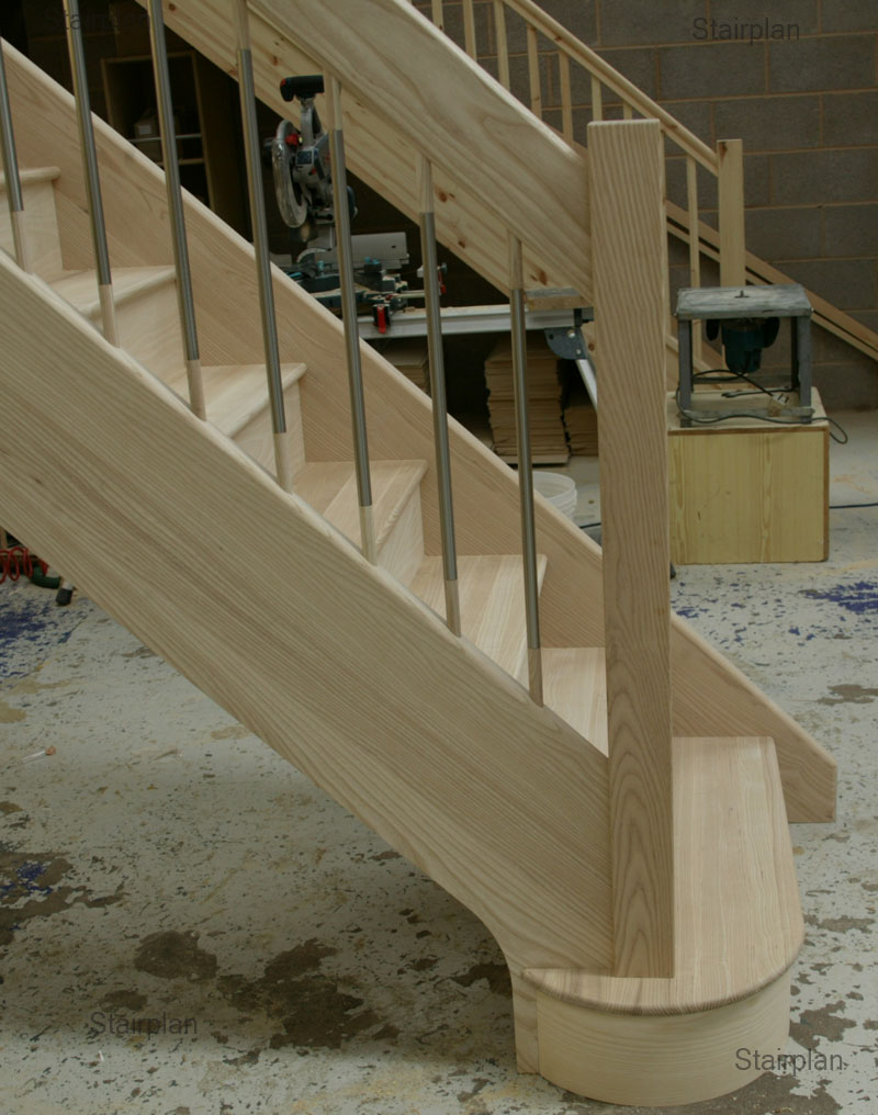 Ash hardwood Staircase with a double curtail entry step