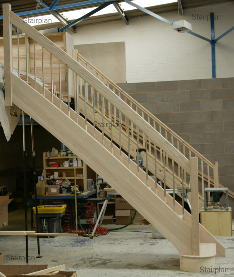 Ash European style staircase with a arched handrail detail