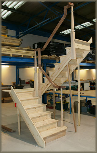 half landing staircase with continuous handrail