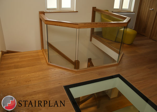 first floor landing balustrade in oak and glass