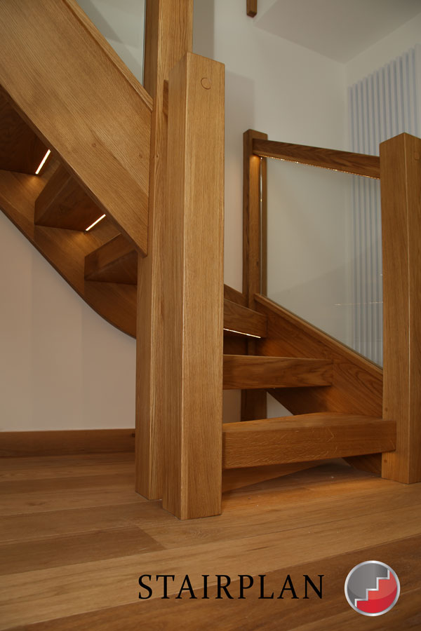 LED stair lighting under treads and inset into the handrail