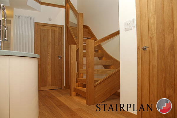 Townsend oak stair with glass balustrade and chunky oak sections