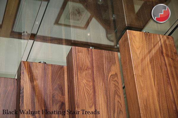 Walnut floating staircase treads