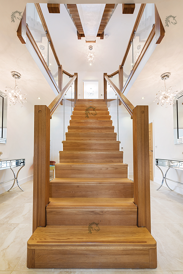 central feature oak staircase glass balustrades to both sides