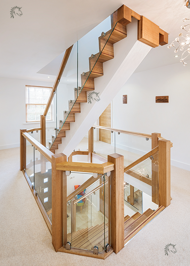 central staircase with glass balustrade